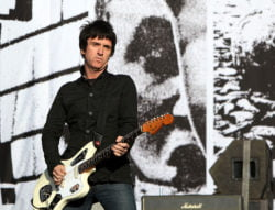 READING, ENGLAND - AUGUST 28: Johnny Marr of The Cribs performs live on the Main stage during day Two of Reading Festival on August 28, 2010 in Reading, England. (Photo by Simone Joyner/Getty Images)